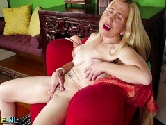 Blonde rubs her moist slot