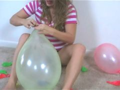 Naughty chubby teen babe Christy playing with balloons on the floor