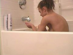 Ponytailed teen seductress Addison showing her assets in bath tub