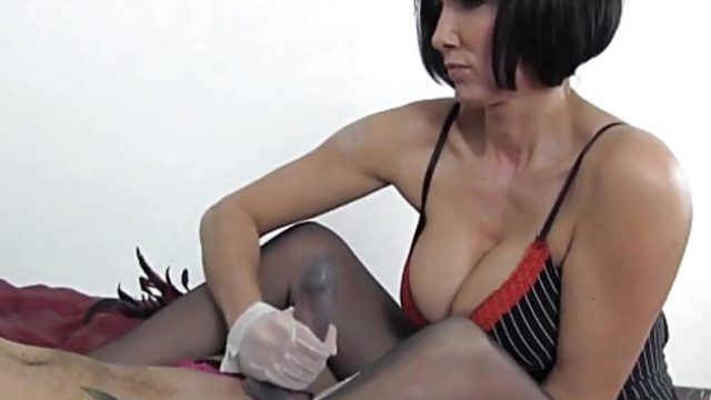 Lingerie clad amateur tugs on this hard dick