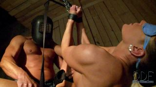 Blindfolded babe is helpless in suspension bondage. She get throat