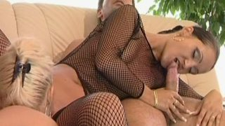 Two hot young lesbians in fishnets sharing a giant dick
