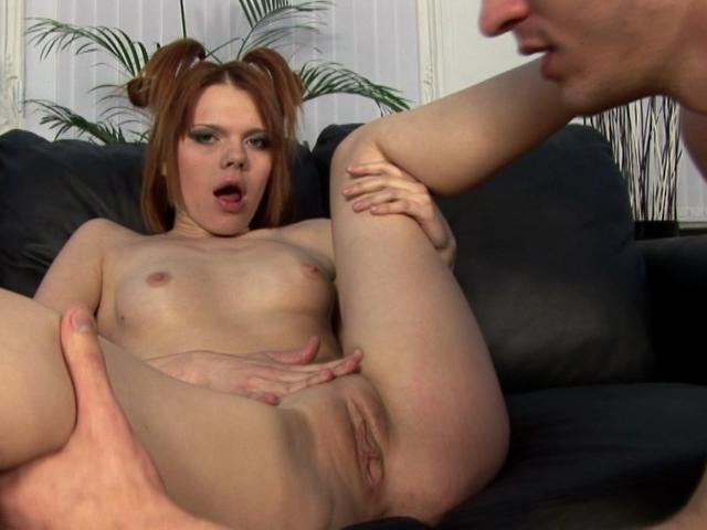 Attractive redhead whore gets skinny muff licked on the couch