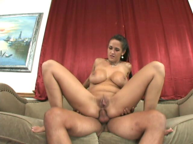 Big titted brunette Carmella Bing sucking a massive cock in a threesome