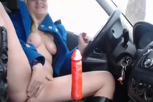 Blonde girl masturbates on the car
