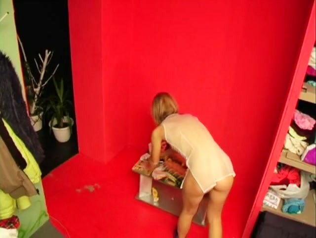Blonde in sheer tunic cleaning her room