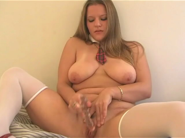 Stockinged blonde schoolgirl Christy showing big jugs and dildoing her chubby pussy in bedroom