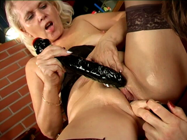 Trashy lesbian grannies Marketa And Leona licking their succulent pussies and sharing a giant dildo
