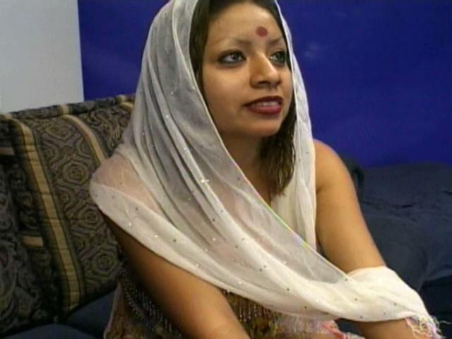 Naughty Indian cutie Indra dancing lascivious and showing her round arse