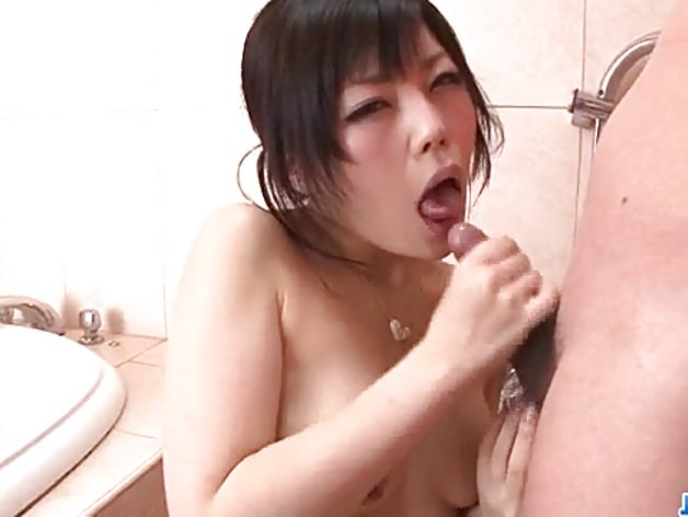Asian brunette swallows this hard cock