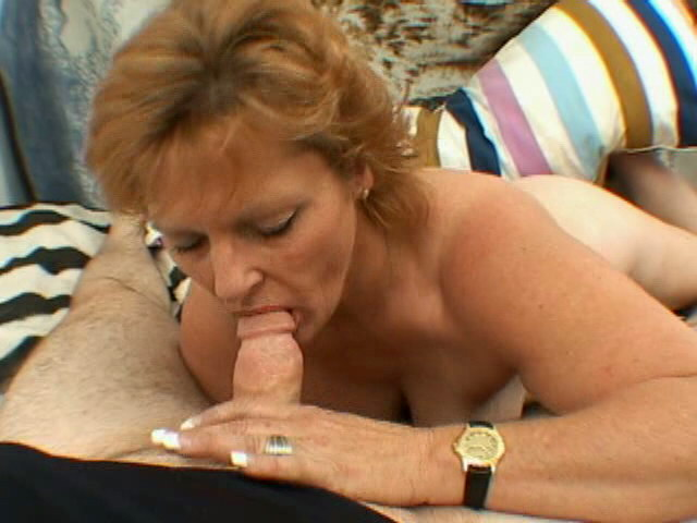 Smiling blonde granny with big tits Megan strips and slurps a thick penis