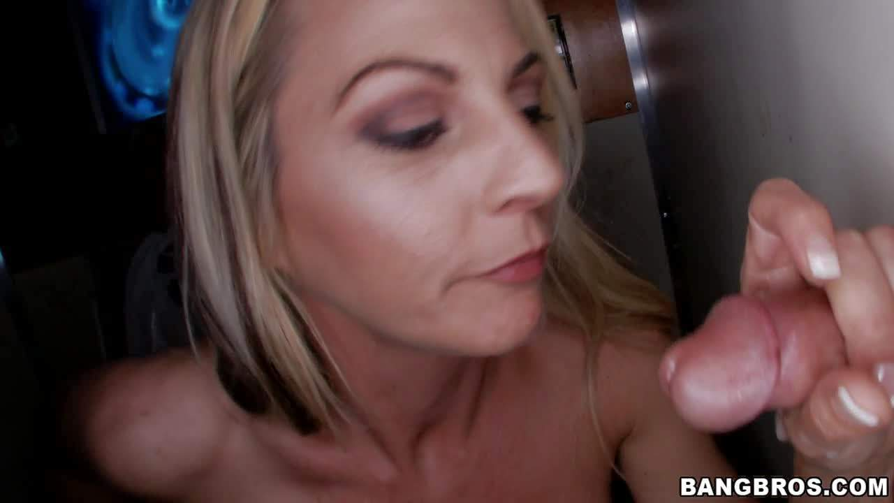 Busty milf Sindy Lange sucking dicks thru glory holes