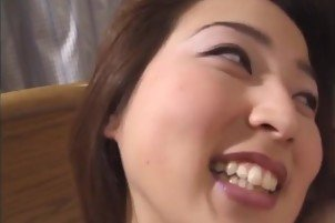 Hot Asian minx Moemi Takagi has fun with a buzzing dildo